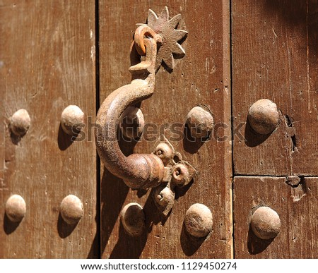 Wooden Door With Old Iron Knocker. Caceres, World Heritage City By Unesco.  Extremadura