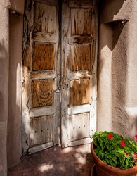 Wooden doors of a traditional styled wall in Santa Fe