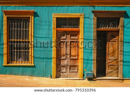 Wooden doors to old tenement house on the street in Valparaiso, Chile, South America