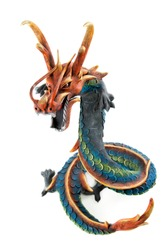 Wooden dragon with open mouth and horn on white background