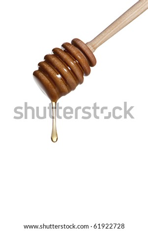Wooden drizzler dripping honey on white background.