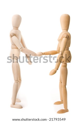 Wooden dummies shaking hands isolated on white