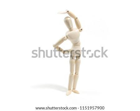 Wooden dummy figure ,Mannequin in exercise pose on white background.