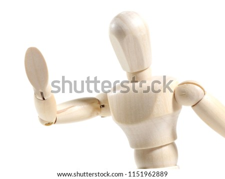 Wooden dummy figure ,Mannequin in waving hello pose on white background.
