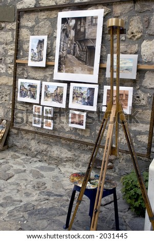 Wooden easel and Painting in the street