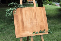 Wooden easel with a board.