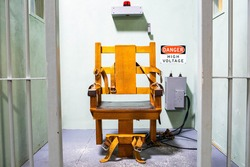 Wooden electric chair for death sentence in prison cell concept