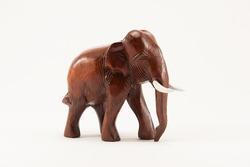 Wooden elephant model on white background