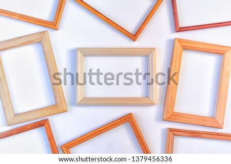 Wooden empty frames laid out on a white background. Layout for the layout. Photo with space for text and images. #1379456336