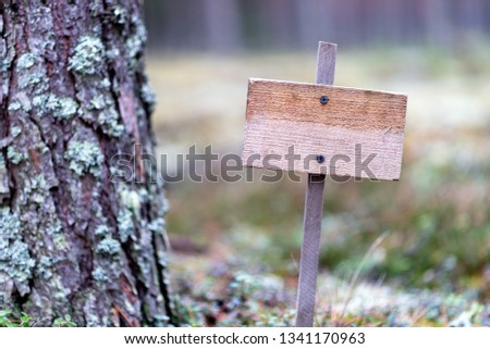 Wooden empty plaque in the forest, solitude, solitude, environmental protection #1341170963