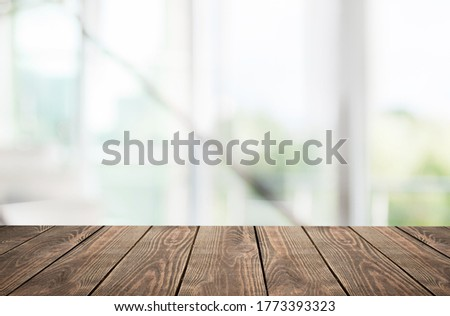 Wooden empty table top in front of blurred window background Stock foto ©