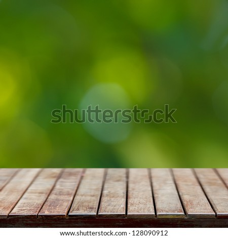 Wooden empty table with natural green background