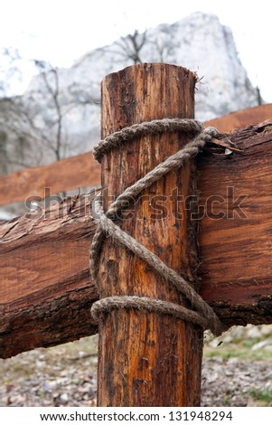 wooden fence and rope on mountain background