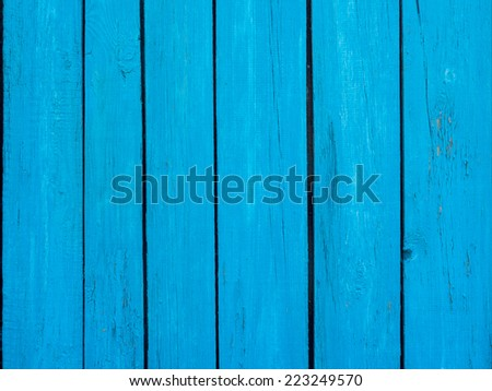 Wooden fence blue background