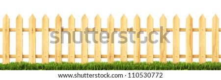 wooden fence in the grass. Isolated on white.
