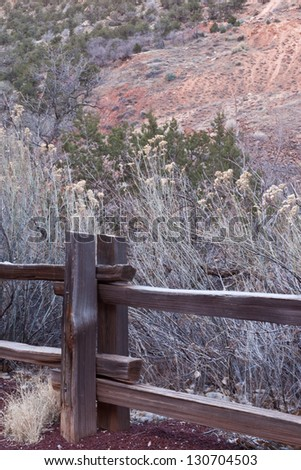 Wooden fence post and tall yellow grasses in Zion\'s National Park