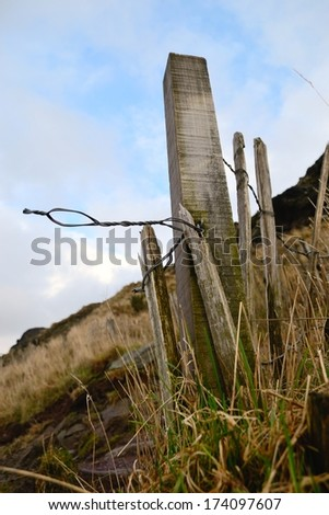 Wooden fence post near the peak of Arthur\'s seat in Edinburgh, Scotland.