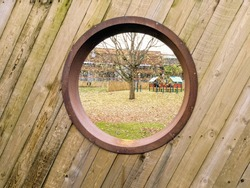 wooden fence with a bog round hoke in it