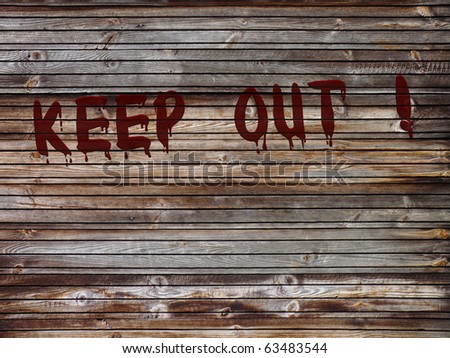 "Wooden fence with bloody text ""KEEP OUT !"""