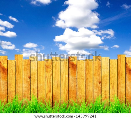 wooden fence with green grass and field on background  #145999241