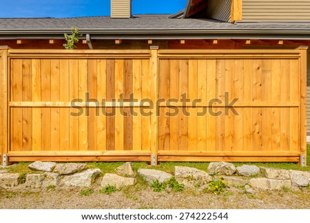 wooden fence with green lawn and houses #274222544
