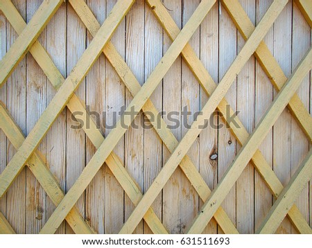 Wooden fence with rhombuses close up #631511693