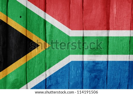 Wooden fence with the flag of South Africa painted on it