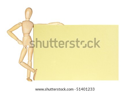 Wooden figure holding a card with space for your text - stock photo