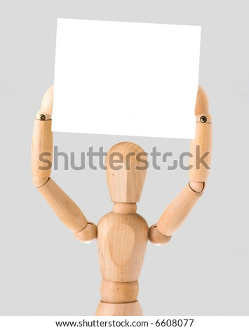wooden figure holding an empty plate - stock photo