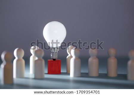 Wooden figures, lightbulb on red cube. Team creativity, idea mockup. Creative approach and lateral thinking, copy space Stock photo ©