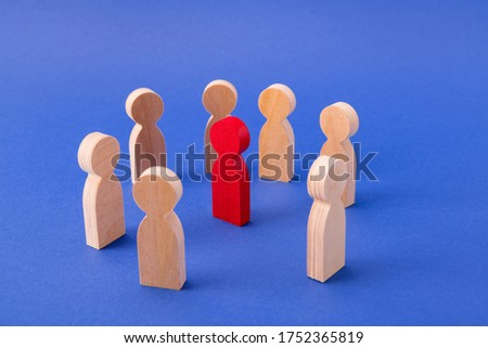Wooden figures of people standing in circle bullying one guy discrimination psychology attack isolated over bright vivid shine vibrant blue color background