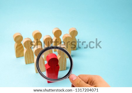 Wooden figures of people. The boss of the business team indicates the direction of movement to the goal. The crowd is following the leader. The concept of leadership and team management. Teamwork. #1317204071