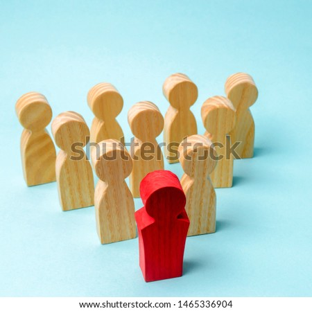 Wooden figures of people. The boss of the business team indicates the direction of movement to the goal. The crowd is following the leader. The concept of leadership and team management. Teamwork. #1465336904