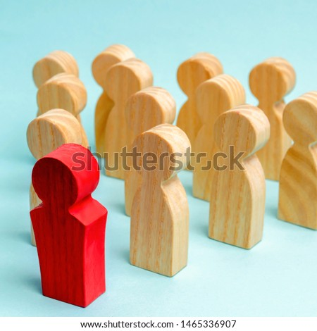 Wooden figures of people. The boss of the business team indicates the direction of movement to the goal. The crowd is following the leader. The concept of leadership and team management. Teamwork. #1465336907