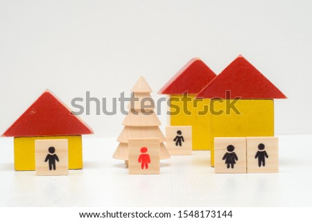 Wooden figures on white background. Real estate concept. Fraud concept. Homeless concept
