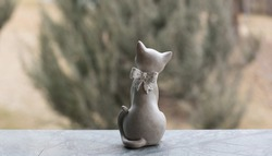 wooden figurine of a cat on a nature background