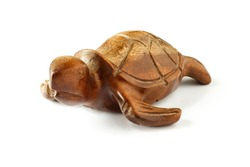 Wooden figurine of a sea turtle on a white background. Isolated