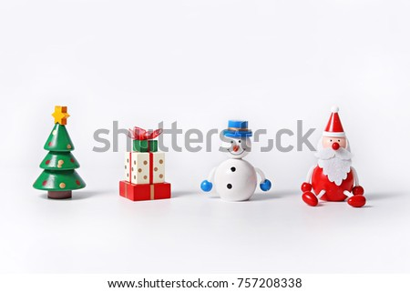 Wooden figurine of Christmas tree, present, Snowman and Santa Claus isolated on white background