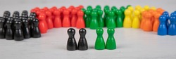 wooden figurines in the colors of German parties, in front four figurines representing the candidates for becoming chancellor