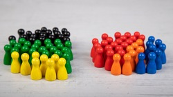 wooden figurines in the colors of German political parties, Green Party, FDP and Christian Democratic Union as government coalition and other parties as opposition