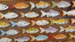 wooden fish hanging on the wall
