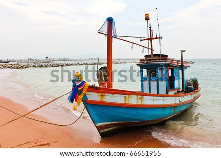 Wooden fishing boat on the beach.
