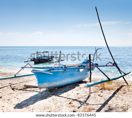 Wooden fishing boat on the shore. Gili islands, Indonesia