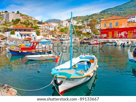 Wooden fishing boats in the beautiful small harbour Kamini of Hydra island in Saronikos gulf in Greece
