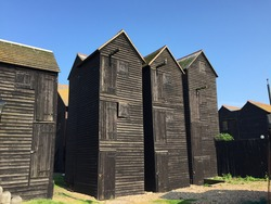 Wooden Fishing Huts in Hastings with blue sky