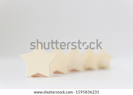 Wooden five star shape on white background. The best excellent business services rating customer experience concept