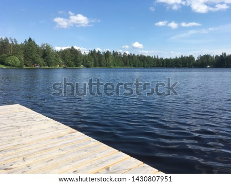 Wooden floating dock on the river. #1430807951