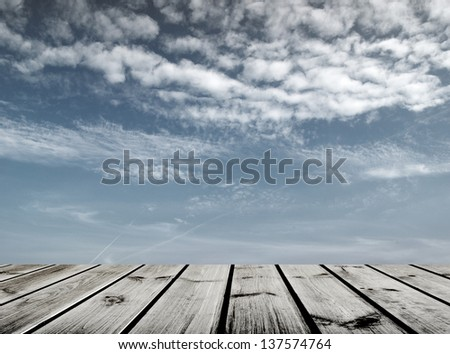 wooden floor and sky background - stock photo