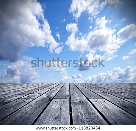 Wooden floor and the sky creative background.