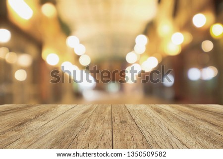 wooden floor terrace with bokeh night lights. vintage style picture.